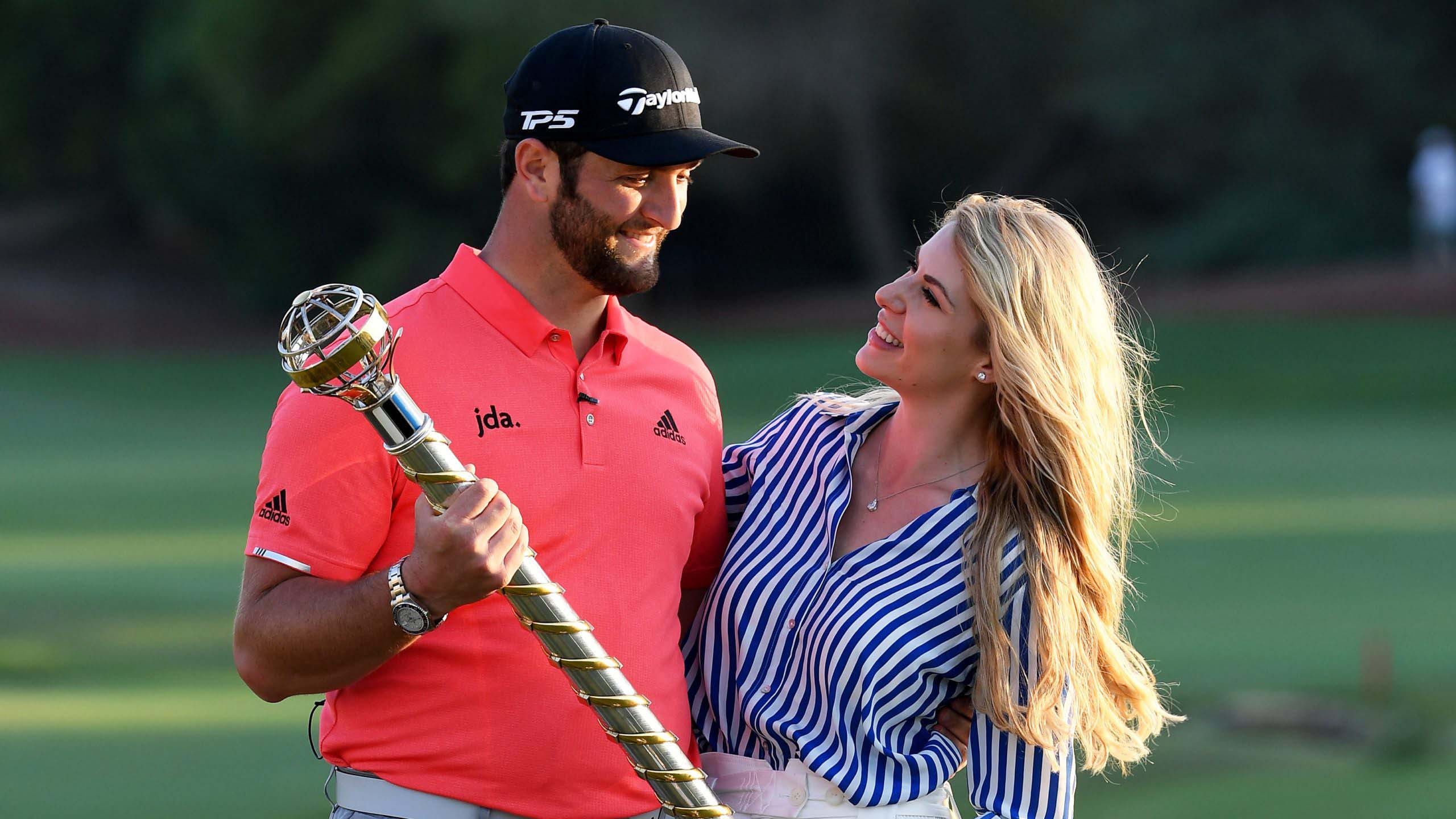 Jon Rahm with his wife