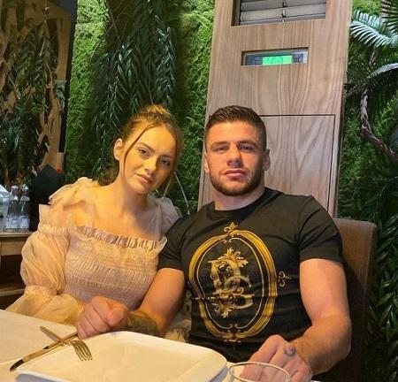 Marku with his girlfriend