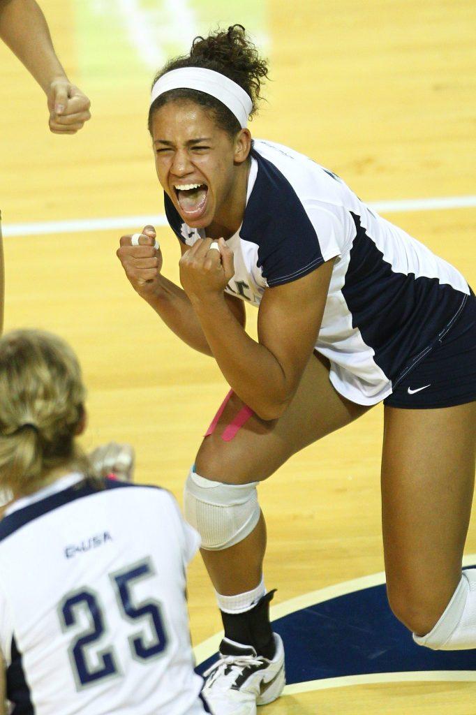 Mariah Riddlesprigger playing volleyball